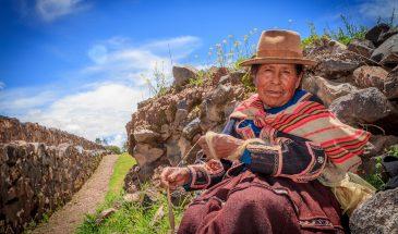 Peruvian Indian Woman in Traditional Dress Weaving